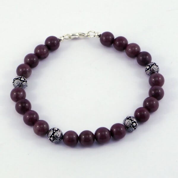 Four delightful highly patterned round antiqued silver beads are spaced between sets of Purple Aventurine gemstones to create this beautiful bracelet.