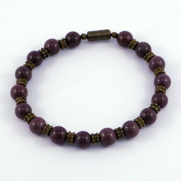 Interesting brass spacers with twin rows of patterning separate the Purple Aventurine stones in this gorgeous unisex bracelet.