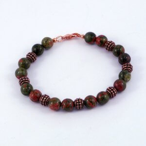 The copper beads support the green and salmon pink tones of these natural stones. These stones in this Unakite & Copper bracelet are not dyed or treated.