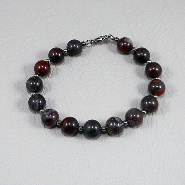 Gunmetal lustre coloured beads and clasp echo the colours of the stone with its dark, smoky base and flashes of red in this understated bracelet.