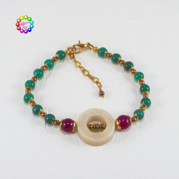 Aventurine Donut and Dyed Malaysian Jade in Magenta and Emerald, small bronze Czech glass beads and smooth scalloped gold bead caps complete the design.