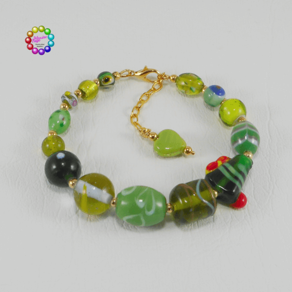 Tropical Island Glass Bead Bracelet A fabulous mix of glass beads in various shades of green is highlighted with splashes of red, yellow and blues