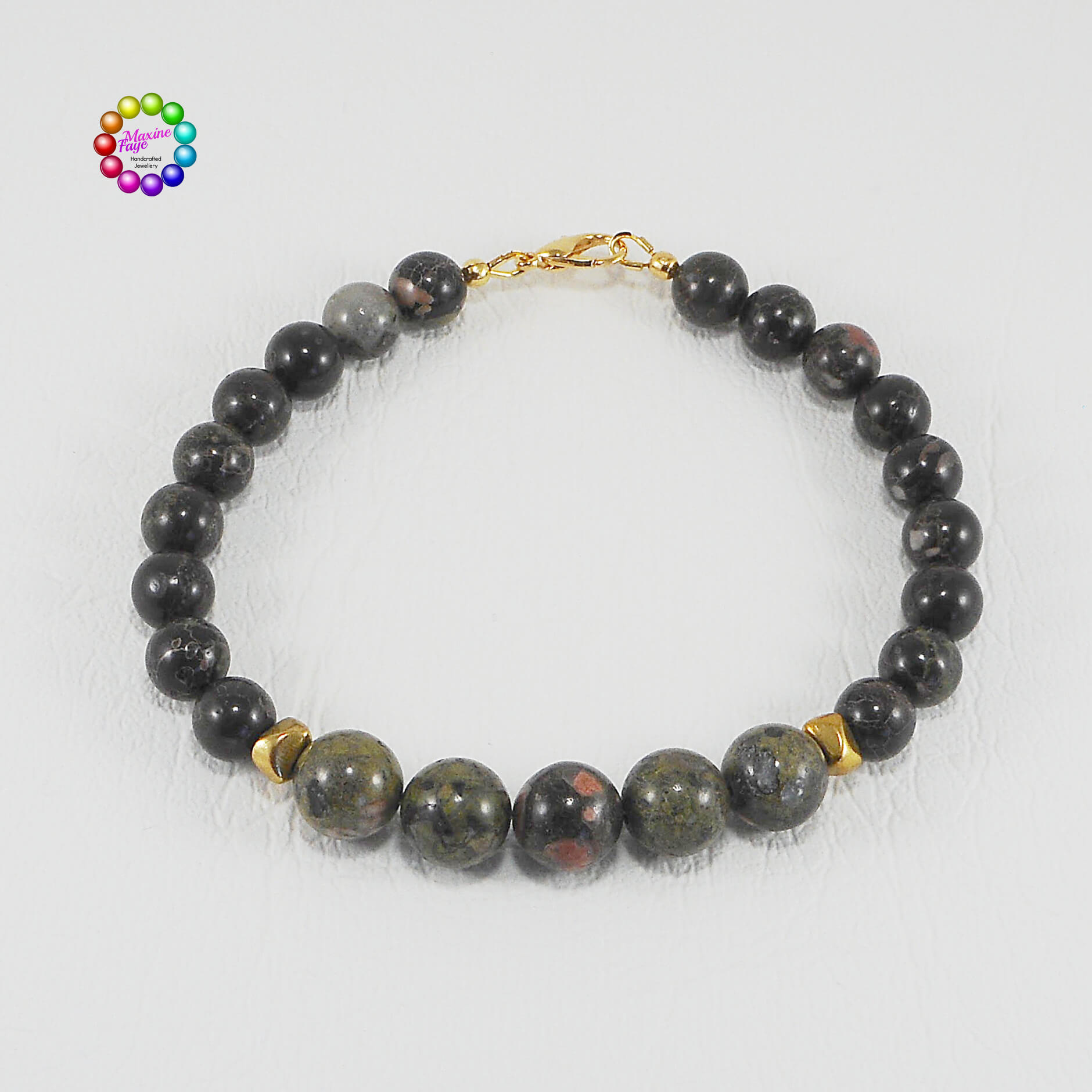 The beautiful earthy colours of the two sizes of natural Sunset Jasper gemstones in this bracelet are separated by 2 brass triangular nugget shaped beads.