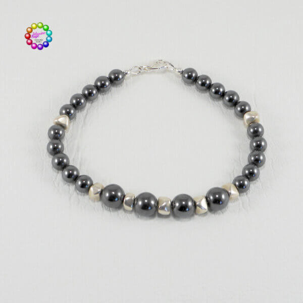 Hematite stone mixes well with the triangular nuggets of silvery coloured white brass which separate each of the larger rounds