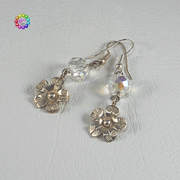 Thai Silver Flower & Faceted Crystal Earrings From a beautiful Clear AB faceted Crystal dangles a Hill Tribes antiqued silver plated flower.