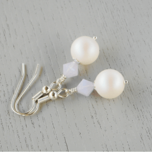 Bryony Crystal Pearl Earrings The frosty iridescence of the Pearlescent White Swarovski 10 mm glass pearls looks fabulous sitting below a