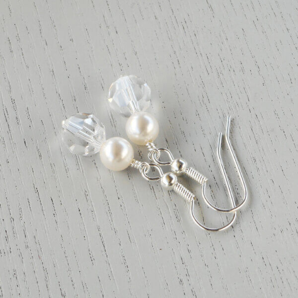 Dahlia Crystal Pearl Earrings Silky and polished like a classic pearl, these 6mm white Swarovski crystal pearls feature a creamy alabaster