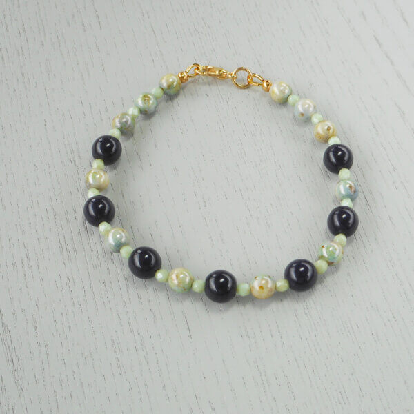 Exmouth Lustre Glass Bracelet Gorgeous green lustre glass and faceted fire-polished glass are paired with the deepest blue glass to create