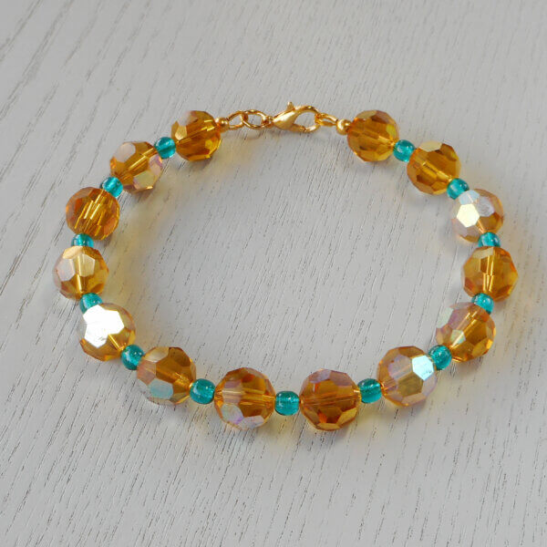 Gold Rush Faceted Glass Bracelet Fabulous faceted golden 10mm glass beads have sections of AB lustre coating to provide even more sparkle
