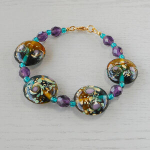 Eucla Lamp-work Glass Bracelet The four 22mm feature beads in this bracelet are from a limited release of lampworked glass.