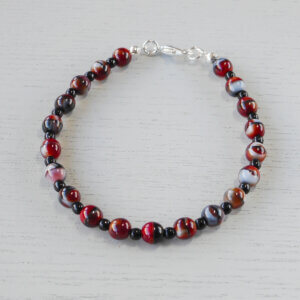 Karijini Bracelet Czech 6mm pressed glass druk beads in red, black and grey are separated by little black glass beads