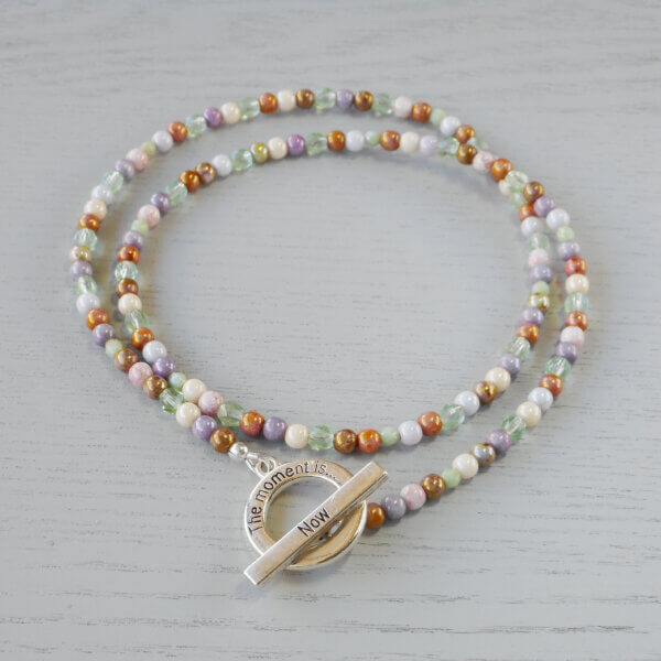 The Moment is Now Necklace This strand of multicoloured pastel glass beads have a beautiful lustre to them.