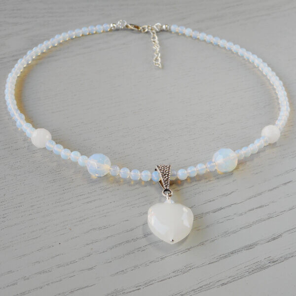 Opalite, Rose Quartz & Crystal Heart Necklace A beautiful translucent white crystal heart with lovely light reflecting facets around the