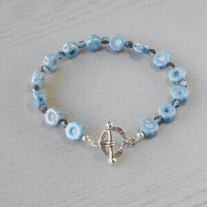 Unusual blue grey octagonal shaped Czech pressed glass beads are separated by similar coloured Czech fire-polished glass crystals.