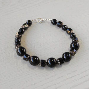 Alice Cathedral Glass Bracelet Spectacular cathedral glass beads separate the round black glass beads to create this elegant bracelet