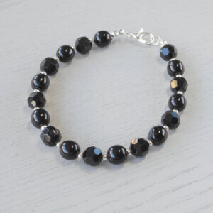 Angelica Bohemian Glass Bracelet Silver spacer beads separate alternating sets of round Czech glass and faceted glass beads to form