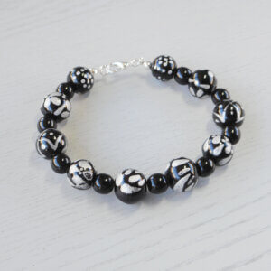 Mystery Hand-Painted Glass Bracelet Alternating sets of plain black and silver and black beads make up this very unusual bracelet.