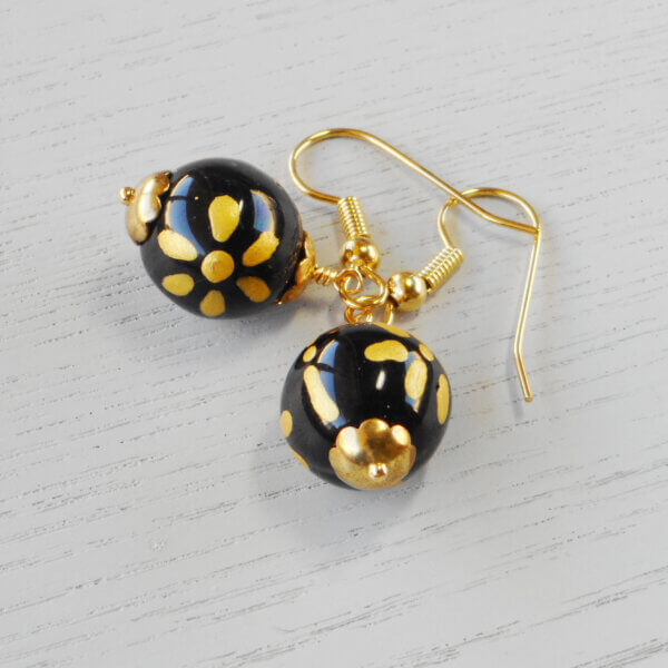 Elegance Hand Painted Glass Earrings The 12mm opaque black glass beads are hand-painted with a gold colour flower design