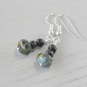 Sylvette Picasso Glass Earrings The organic colours in the marbled effect of the main bead are complemented by the textured charcoal grey