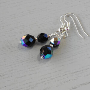 Karleen Faceted Glass Earrings These two different sized faceted black fire-polished glass beads form these fabulous earrings.