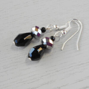 Shine Faceted Rondel Glass Earrings Beautiful, faceted glass rondel beads in Metallic silver sit upon a black faceted glass teardrop to
