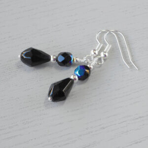 Jessie Faceted Glass Earrings Czech fire-polished glass beads in Jet AB sit upon a black faceted glass teardrop to create these earrings