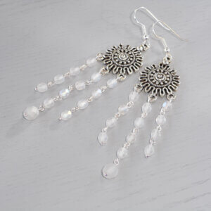 Moonlit Nights Chandelier Earrings Three strands of faceted AB opal matte Czech fire-polished glass beads fall from a circular patterned