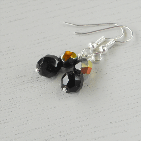 Starry Night Faceted Glass Earrings Faceted black fire-polished glass beads form these fabulous earrings. The 6mm top bead has a beautiful metallic lustre to one side of it creating delightful little flashes of light when they move.