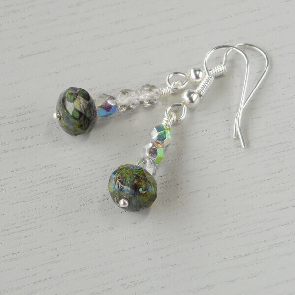 Picasso Glass Earrings These earrings certainly are pretty ones. The green in the marbled effect of the main beads is repeated in a metallic