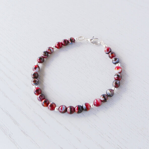 Karratha Pressed Glass Bracelet Czech 6mm pressed glass beads in red, black and grey make up this gorgeous stacker style bracelet.