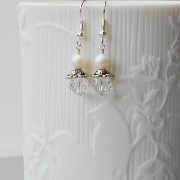 Ruth Pearl & Crystal Earrings A gorgeous frosty iridescence 6mm Swarovski Pearlescent White glass pearl sits above an equally beautiful Clear
