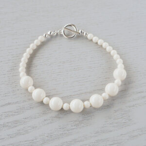 Ava Ivory Glass Crystal Bracelet The rich cream of 4mm & 8mm Ivory Swarovski glass pearls bring an Old World charm to this bracelet.