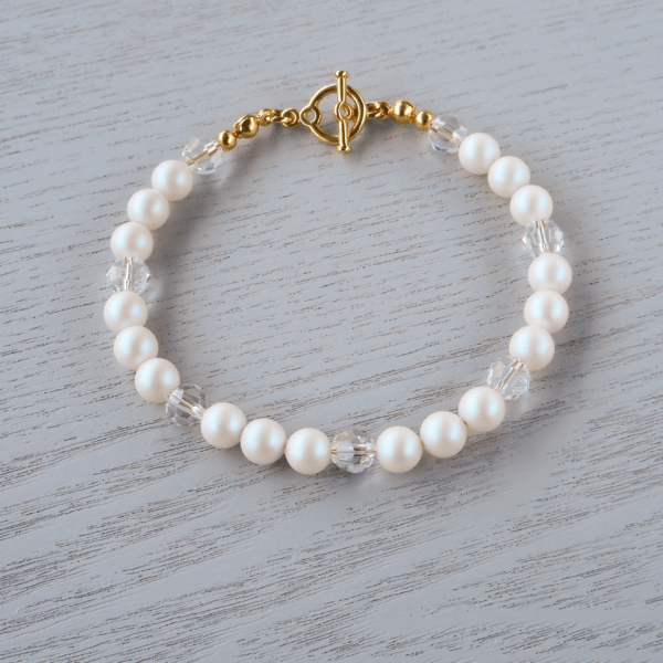 Rayne Glass Crystal Bracelet Sets of Pearlescent White Swarovski 6mm glass pearls looks fabulous in their frosty iridescence sitting each
