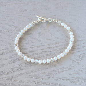 Valarie Glass Crystal Bracelet Sets of Pearlescent White Swarovski pearls are separated by Swarovski crystal in Crystal Moonlight which adds