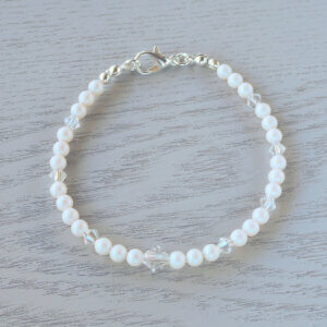 Valentina Glass Crystal Bracelet Sets of Pearlescent White Swarovski pearls are separated by Swarovski crystal in Crystal Moonlight which