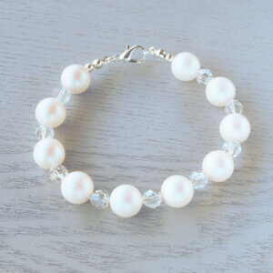 Adelaide Glass Crystal Bracelet The frosty iridescence of the Pearlescent White Swarovski 8mm glass pearls looks fabulous sitting between