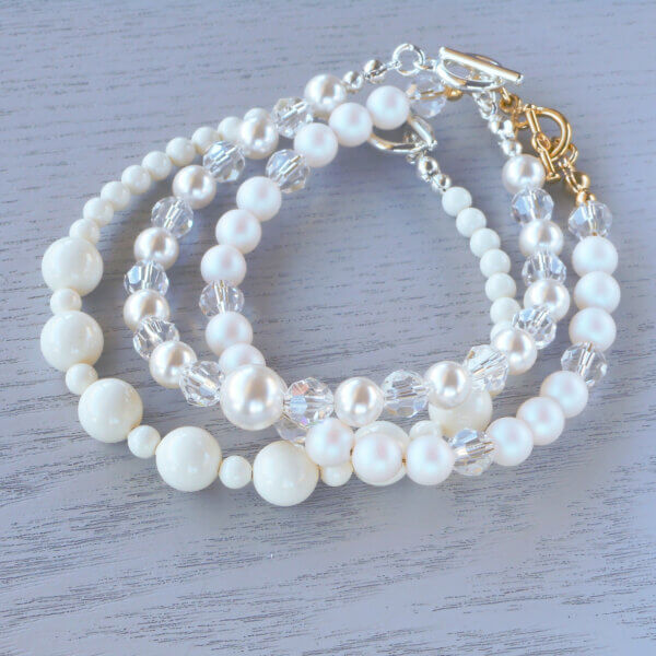 a stack of white pearl bracelet