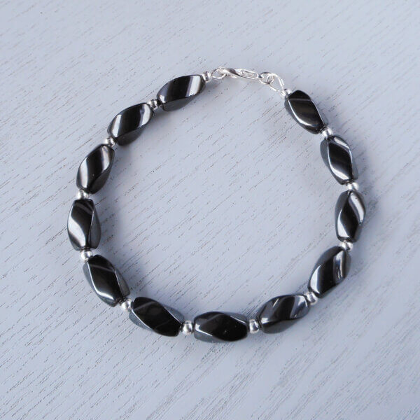 The deep dark metallic grey/black neutral colour of this magnetic Hematite stone mixes well with the silver coloured metal.