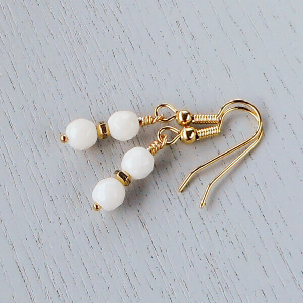 Coralyn Faceted White Coral Earrings Hexagonal patterned rondels sit between the beautiful 6mm faceted White Coral beads.